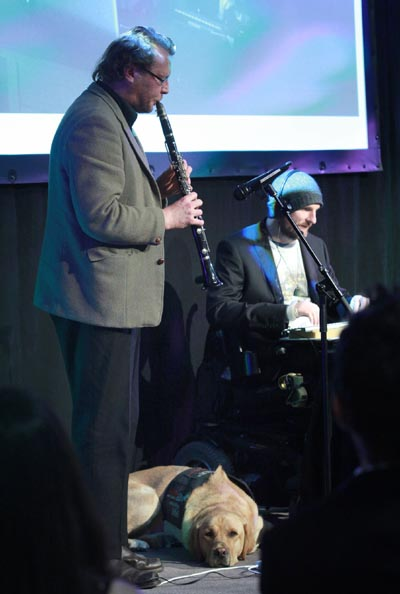Andrew McMillan performs with saxophonist Jeff Henderson at the Big 'A' Awards ceremony