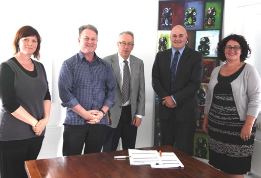 Jacqui Moyes, Richard Benge and Howard Fancy (Arts Access Aotearoa), with Stephen Cunningham and Barbara Jennings (Department of Corrections) sign the contract