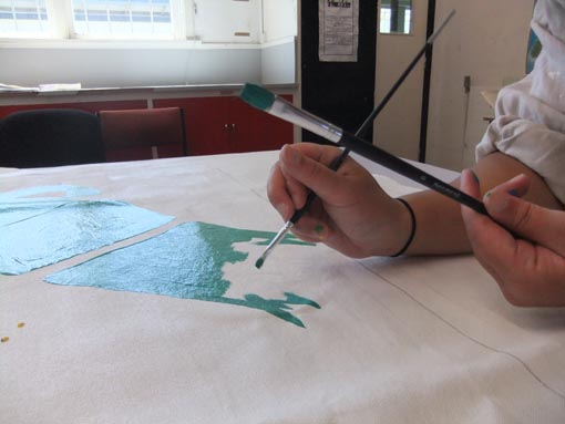 Working on a mural at Arohata Prison
