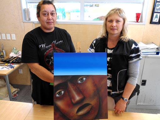 Theresa Reihana and Sandra Harvey with a painting donated by Theresa to sell and use the proceeds to buy art materials for the art classes