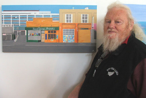 Brent Bartram with one of his paintings