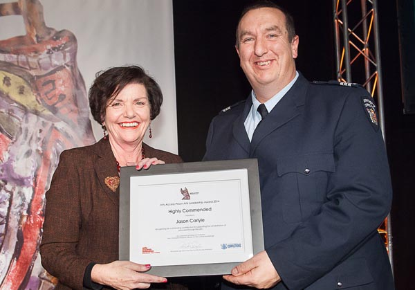 Hon Anne Tolley and Jason Carlyle, receiving the Highly Commended citation in the Arts Access Prison Arts Leadership Award 2014