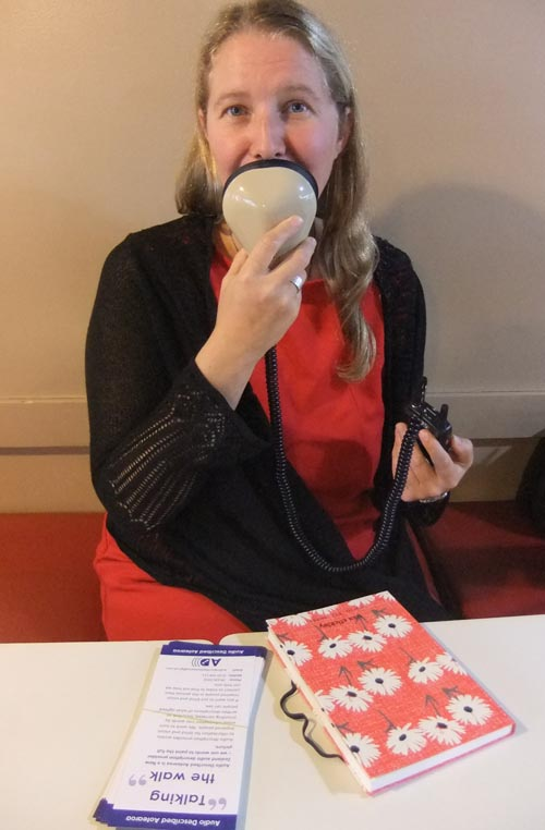 Audio describer Nicola Owen talks into a stenomask