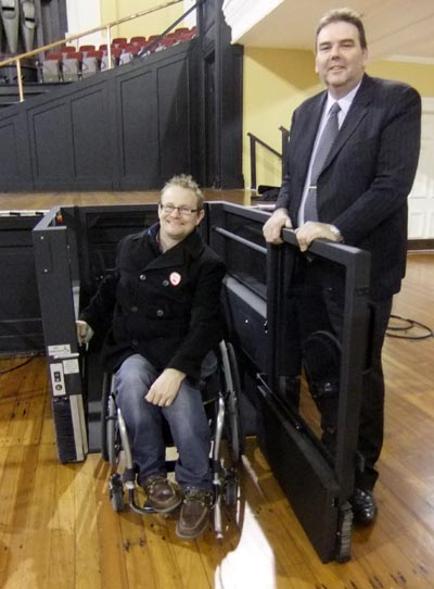 Kendall Akhurst, about to enter the wheelchair stage lift, and Craig Woolliams