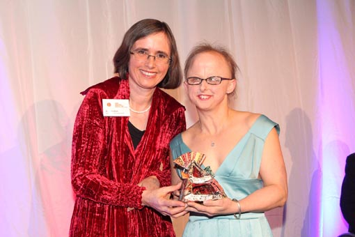 Sarah Houbolt receives the Artistic Achievement Award 2012 from MP Mojo Mathers