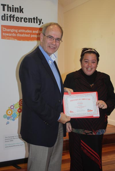 Mayor Len Brown presents a certificate to participant Loren Glenn