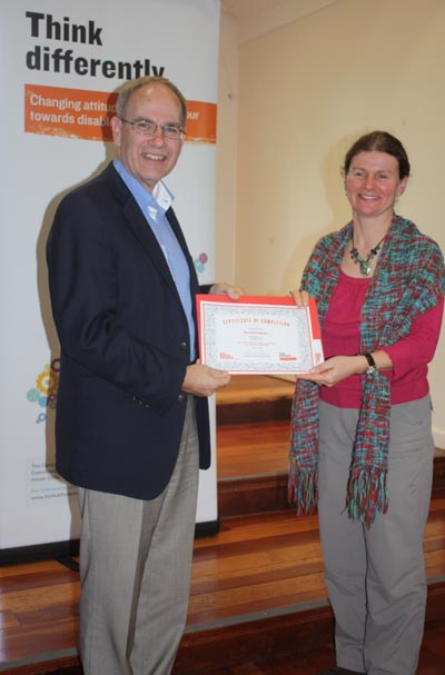 Auckland Mayor Len Brown presents a certificate to participant Rachel Coppage  Photo: Debra Bathgate