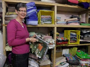 Jo, one of the volunteers  in the quilting storeroom