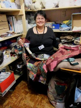 Trisha, a volunteer quilter in the storeroom