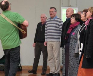 Julian Raphael and members of the Wellington Community Choir
