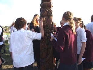 Albany Junior High School students gather around the poupou