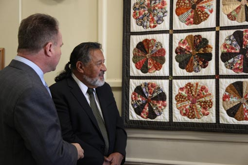 Richard Benge and the Hon Dr Pita Sharples admire the Dresden Plate Quilt in Parliament House